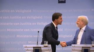 Dutch PM Mark Rutte shakes hands after delivering a speech in which he told citizens to stop handshakes to prevent the spread of COVID-19