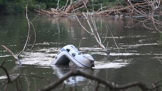 A boat sunk in the river that separates Turkey from Greece.