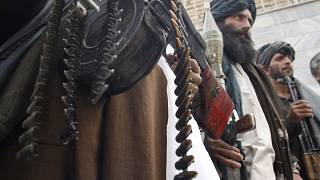 Former Taliban militants hold their heavy and light weapons Herat province west of Kabul, Afghanistan, March 10, 2009.