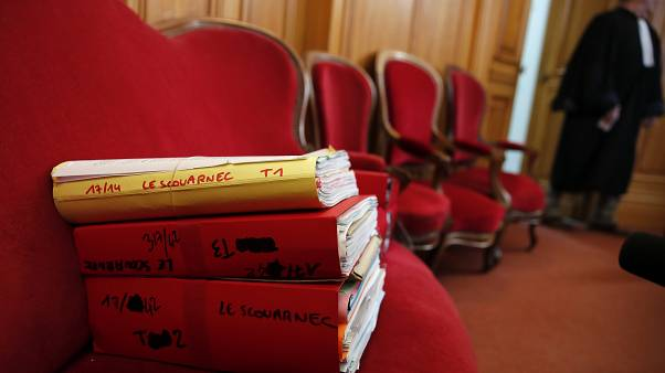 The judiciary files of retired French surgeon Joel Le Scouarnec are displayed on the opening day of his trial in the courthouse of Saintes
