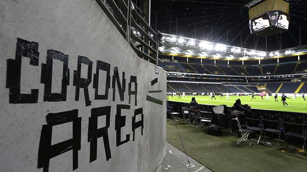 Eintracht fans have taped letters at a wall of the stadium during a Europa League round of 16, 1st leg soccer match between Eintracht Frankfurt and FC Basel.