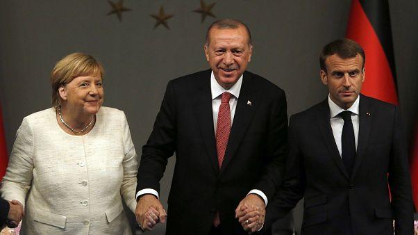 Almanya Başbakanı Angela Merkel, Cumhurbaşkanı Recep Tayyip Erdoğan, Fransa Cumhurbaşkanı Emmanuel Macron