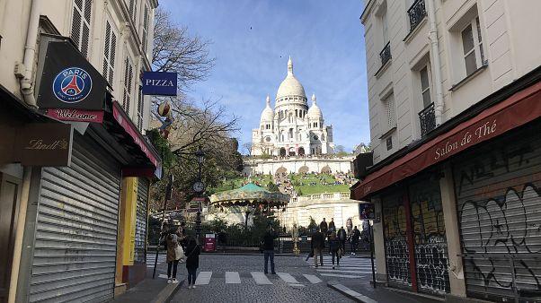 Some local businesses shut near Sacré-Cœur Basilica in Paris. The landmark remains popular among visitors, despite the fears of coronavirus spreading. 15 March, 2020.