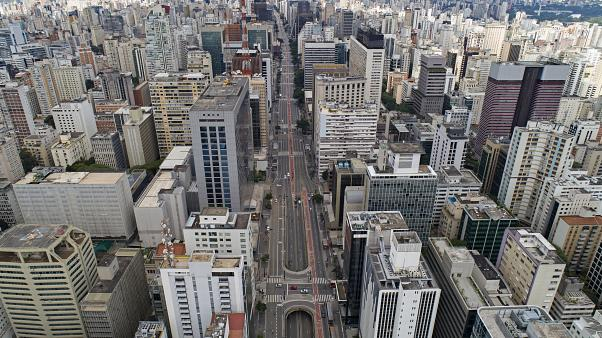 An aerial view of the almost empty Paulista Avenue, one of Sao Paulo most important financial centre, on the first day of quarantine. Brazil.