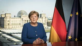 German Chancellor Angela Merkel poses for a photo during the recording of her first direct TV address to the nation in over 14 years in power, at the chancellery in Berlin.