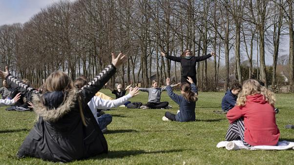An outdoor music lesson at the Korshoejskolen in Randers, Denmark, Wednesday, April 15, 2020, as the country begins to relax its strict coronavirus lockdown measures.
