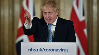 Britain's Prime Minister Boris Johnson gestures, during a coronavirus news conference at 10 Downing Street, in London, Thursday, March 19, 2020.