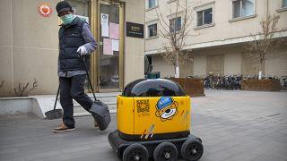 Virus Outbreak China Robot Maker
