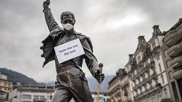 The statue of Freddie Mercury wearing a protective facemask, adorned with a message raising awareness against the spread of the COVID-19, Switzerland