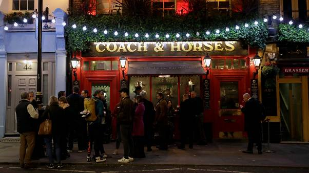 Londonders enjoy a drink at a crowded pub on St Patrick's Day amid a worsening coronavirus crisis