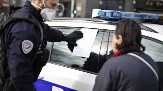 French police fine a woman breaking the conditions of the lockdown
