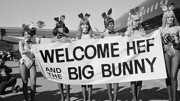 Playboy Bunnies welcome Hugh Hefner on the inaugural flight of his new DC-9 jetliner, The Big Bunny, March 17, 1970. The women are unidentified. (AP Photo/George Brich)
