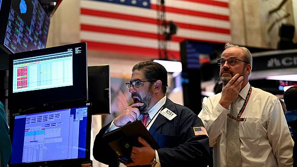 Traders work during the closing bell at the New York Stock Exchange (NYSE) at Wall Street in New York City on March 18, 2020.