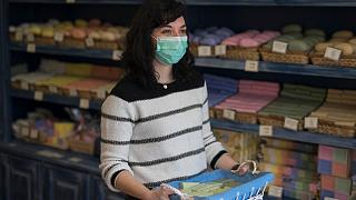 Melanie Dinot, a retail worker at the Savonnerie de la Licorne poses for a portrait hours before nationwide confinement measures were in effect in Marseille, France, March 17.