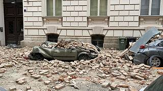 A car is crushed by failing debris after an earthquake in Zagreb, Croatia, Sunday March, 22, 2020.