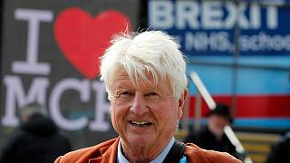 Stanley Johnson, father of Britain's Prime Minister Boris Johnson arrives at the Conservative Party Conference in Manchester, England, Tuesday, Oct. 1, 2019.