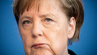 German Chancellor Angela Merkel makes a press statement. (Photo by Michael Kappeler / POOL / AFP)