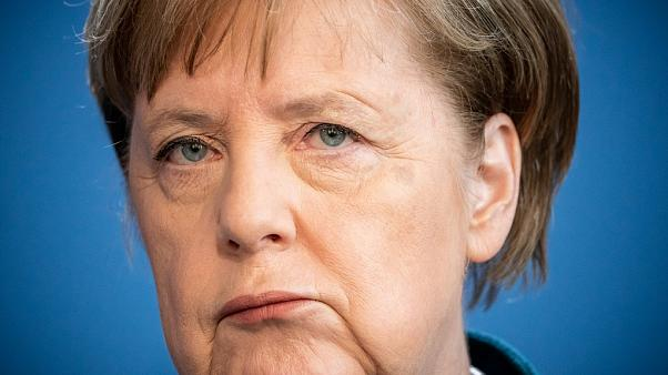 German Chancellor Angela Merkel makes a press statement. (Photo by Michael Kappeler / POOL / AFP)
