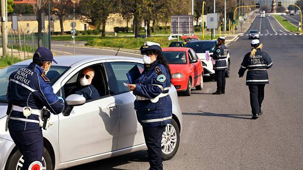 Members of the Rome Local Police check the documents and the self-declarations of motorists on the Via Pontina, in Rome, on March 21, 2020