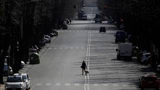 A woman walks her dog in a Rome neighbourhood amid a nationwide lockdown in italy