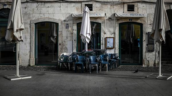 Closed restaurants are pictured in downtown Lisbon