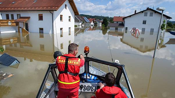 Members of the German Life-Saving Association patrol onboard a boat through the flooded streets in Deggendorf, Bavaria, 5 June 2013