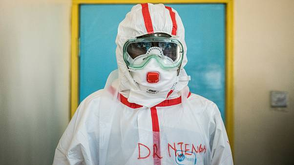 A doctor gets ready with protective gears before visiting the ward for quarantined people who had close contacts with the Kenyan patient of the COVID-19