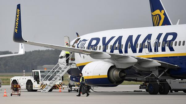 In this Sept. 12, 2018 file photo, a Ryanair plane parks at the airport in Weeze, Germany.
