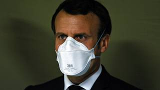 French President Emmanuel Macron wears a face mask during the visit of the military field hospital in Mulhouse, eastern France, on March 25, 2020