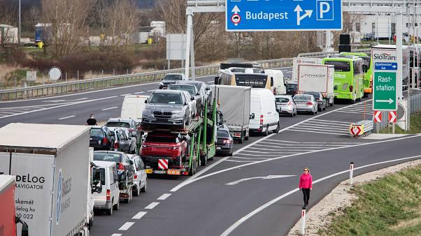 Drivers wait in the traffic jams on the A4 motorway towards Hungary. (Photo by ALEX HALADA / AFP)