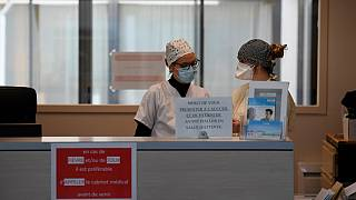 Nurses wearing protective face masks are pictured