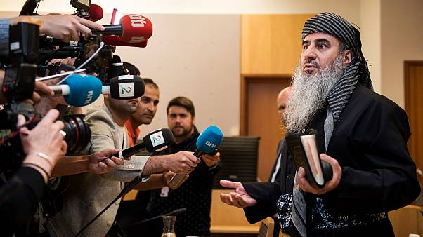 Mullah Krekar faces the media in a District Court in Oslo, Norway, Wednesday July 17, 2019.