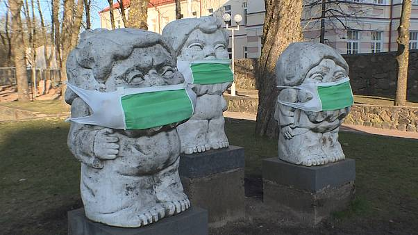 Coronavirus: masked statues make cultural comment and health reminder in Lithuania