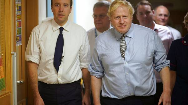 UK health minister Matt Hancock (left) with Prime Minister Boris Johnson