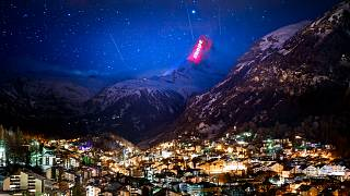 The Matterhorn mountain is illuminated by light artist Gerry Hofstetter aiming to send messages of hope and support to the ones suffering from COVID-19. Zermatt, Switzerland