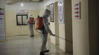 Members of a humanitarian aid agency disinfect Ibn Sina hospital as prevention against coronavirus in the city of Idlib, Syria, Thursday, March 19, 2020.