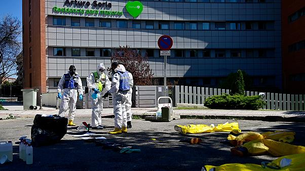 Members of the Military Emergencies Unit (UME) prepare to carry out a general disinfection at the Arturo Soria residence for the elderly in Madrid on March 28, 2020