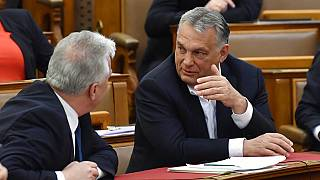 Hungarian Prime Minister Viktor Orban, right, chats with his deputy Zsolt Semjen during a plenary session of the Parliament in Budapest, Hungary