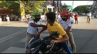 Indian police wear coronavirus helmets to spread lockdown message