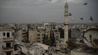 Damaged buildings in Idlib, Syria, just one of many cities ruined by a decade of war