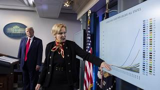 Dr. Deborah Birx, White House coronavirus response coordinator, gestures to a chart as President Donald Trump listens as they speak about the coronavirus