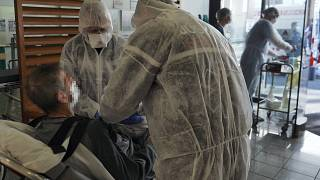 Medical personnel prepare a Covid-19 infected patient at the universitary hospital (CHU) of Tours, France, March 31, 2020 (Photo by GUILLAUME SOUVANT / AFP)