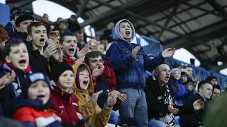 In this photo taken on Friday, March 27, 2020, young fans react during the Belarus Championship soccer match between Torpedo-BelAZ Zhodino and Belshina Bobruisk.