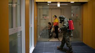 An entrance to a hospital in Barcelona is disinfected