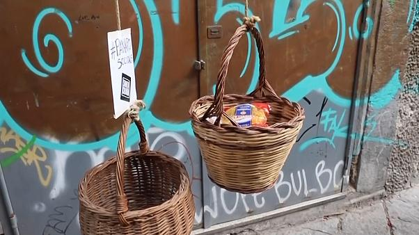 Baskets of solidarity lowered from Naples balconies amid coronavirus chaos