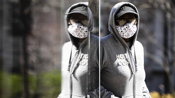 A person wearing protective masks due to coronavirus concerns walks in Philadelphia, Thursday, April 2, 2020.