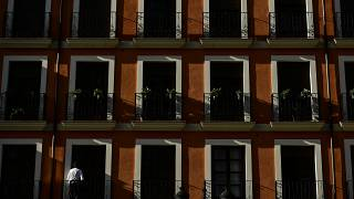 A man leaves the balcony of building during lockdown against the spread of coronavirus COVID-19, in Logrono northern Spain, Saturday, March 28, 2020.