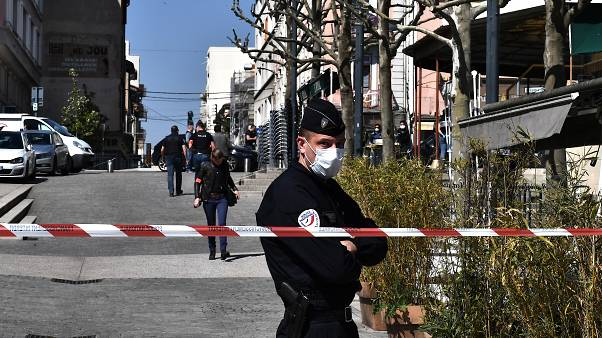 French Police officers stand in a street in the centre of Romans-sur-Isere, on April 4, 2020.