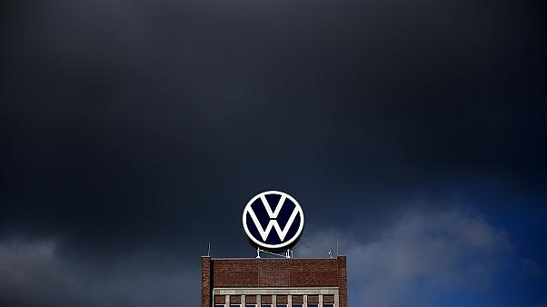 Dark clouds hang over the company headquarters of German car maker Volkswagen (VW) in Wolfsburg on February 28, 2020