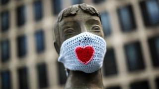 A statue wears a knitted face mask during a partial lockdown against the spread of the Covid-19 coronavirus in Brussels, Belgium